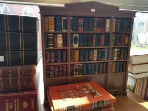 One of the first sights in the shop the 76 miniature classic book collection in a cabinet
